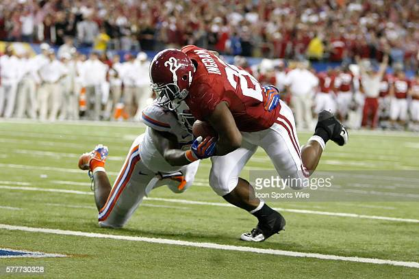 Alabama running back Mark Ingram rushes in for a touchdown over Florida linebacker Brandon Spikes in the Alabama Crimson Tide 3213 victory over the...