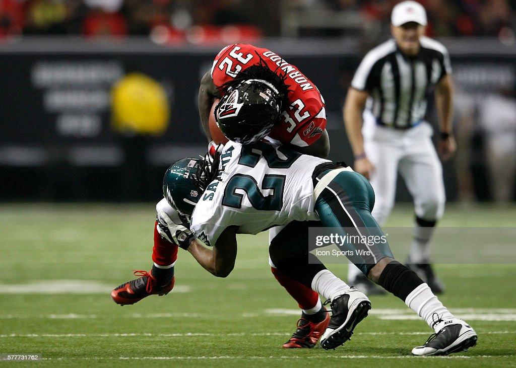 Atlanta Falcons running back Jerious Norwood (32) is tackled by Philadelphia  Eagles cornerback Asante