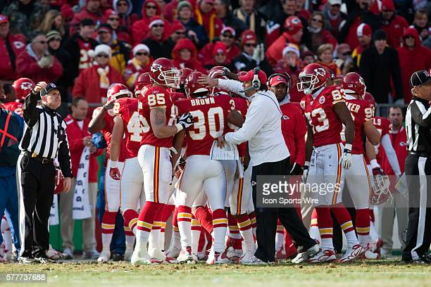 Kansas City Chiefs head coach Todd Haley congratulates safety Mike Brown after he made a play during the Cleveland Browns 4134 win over the Chiefs at...