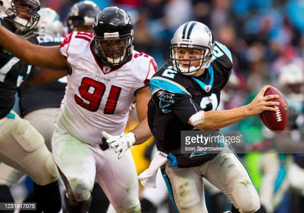 Carolina Panthers quarterback Jimmy Clausen scambles away from Atlanta Falcons defensive tackle Corey Peters during an NFL football game at Bank of...