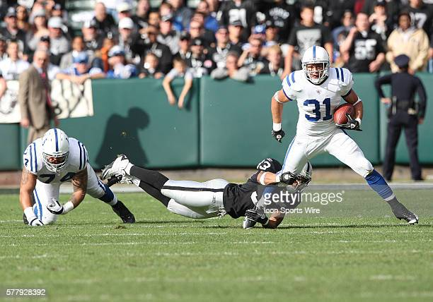 Oakland Raiders safety Tyvon Branch tries to tackle Indianapolis Colts running back Donald Brown as the Colts beat the Raiders 3126 at OaklandAlameda...
