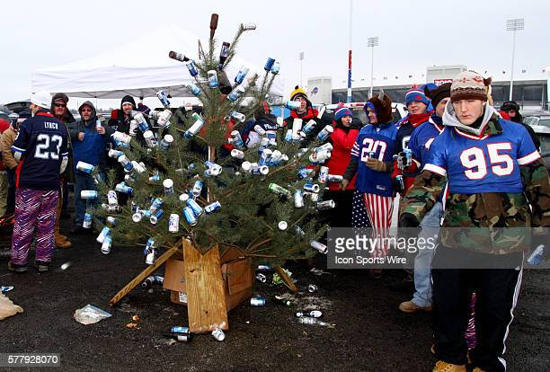 The Buffalo gather around a christmas tree decorated with beer cans as ornaments outside of Ralph Wilson Stadium in Orchard Park NY