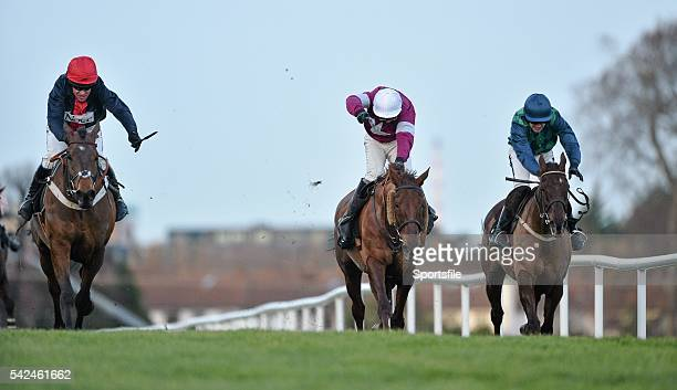 December 2013; Bobs Worth, with Barry Geraghty up, left, crosses the finish line ahead of First Lieutenant, centre, with David Casey up, and third...