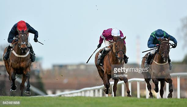 December 2013; Bobs Worth, with Barry Geraghty up, races ahead of First Lieutenant, centre, with David Casey up, and third placed finisher Rubi Ball,...