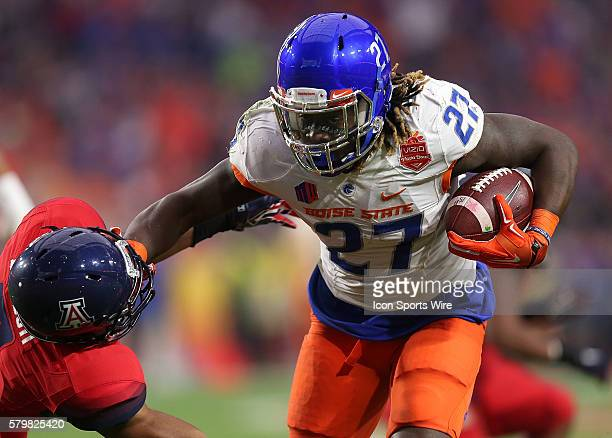 Boise State Broncos running back Jay Ajayi stiff arms Arizona Wildcats cornerback Cam Denson during the first quarter of the Vizio Fiesta Bowl game...
