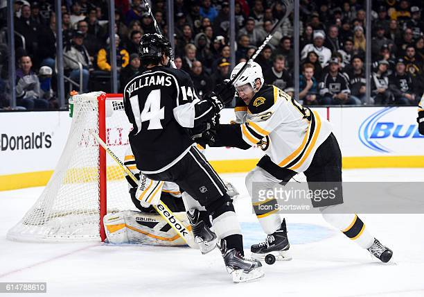 Boston Bruins Defenseman Zach Trotman [7240] shoves Los Angeles Kings Right Wing Justin Williams [2150] away from the puck during an NHL game between...