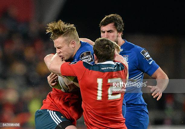 26 December 2014 Ian Madigan Leinster is tackled by Denis Hurley and Stephen Archer Munster Guinness PRO12 Round 11 Munster v Leinster Thomond Park...