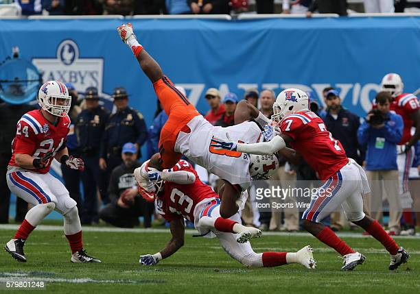 Illinois Fighting Illini wide receiver Geronimo Allison gets flipped by Louisiana Tech Bulldogs defensive back Le'Vander Liggins and defensive back...