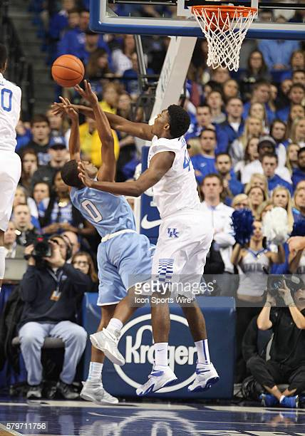 Kentucky Wildcats center Dakari Johnson blocks a shot by Columbia Lions guard Kyle Castlin in a game between the Columbia University Lions and the...