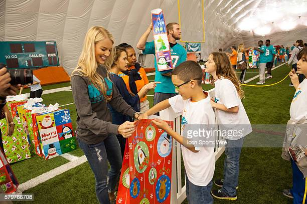 Lauren Tannehill handing out gifts Miami Dolphins players coaches cheerleaders Miami Dolphins Women's Organization members and mascot TD will welcome...