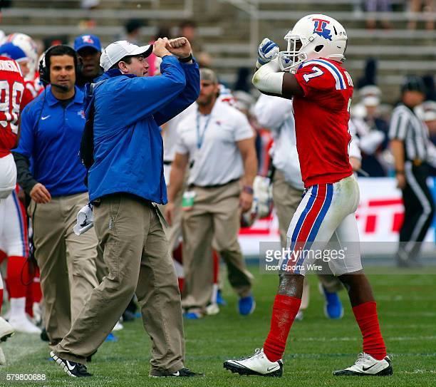 Louisiana Tech Bulldogs defensive back Xavier Woods comes to the bench after his 69-yard interception returned for a touchdown during the Zaxby's...