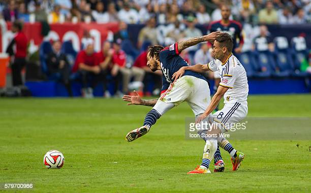 New England Revolution midfielder Jermaine Jones and Los Angeles Galaxy midfielder Marcelo Sarvas tangle during the MLS Cup between the Los Angeles...