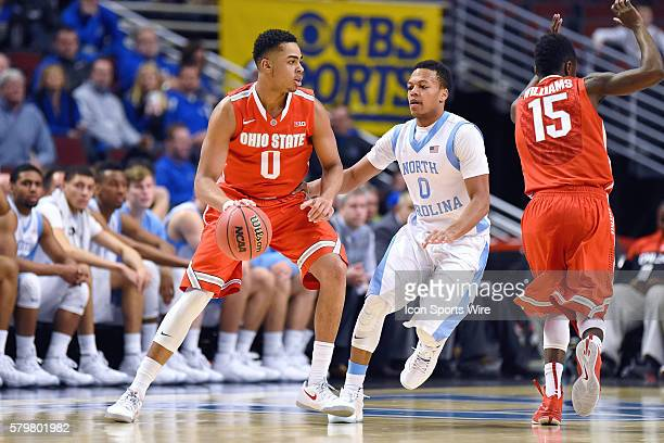 Ohio State Buckeyes guard D'Angelo Russell battles with North Carolina Tar Heels guard Nate Britt in action during the CBS Classic match between the...