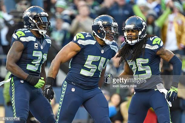 Seattle Seahawks Linebacker Bobby Wagner [17593] celebrates with Seattle Seahawks Cornerback Richard Sherman [17049] and Seattle Seahawks Safety Kam...