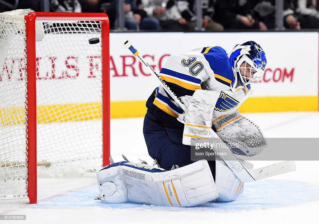 St Louis Blues Goalie Martin Brodeur 262 Flinches As The Puck Is