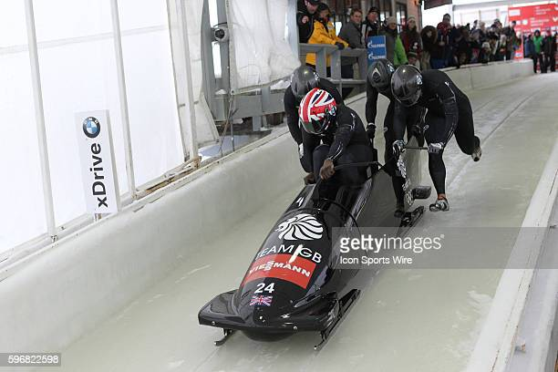The Great Britain 2 bobsled driven by Lamin Deen with sidepushers Keith McLaughlin and Justin OroCampos and brakeman Andrew Matthews slides on the...