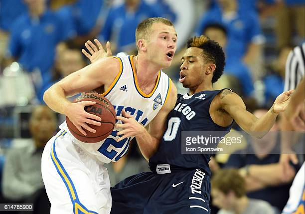 UCLA Bryce Alford elbows San Diego Christopher Anderson during an NCAA basketball game between the University of San Diego Toreros and the UCLA...