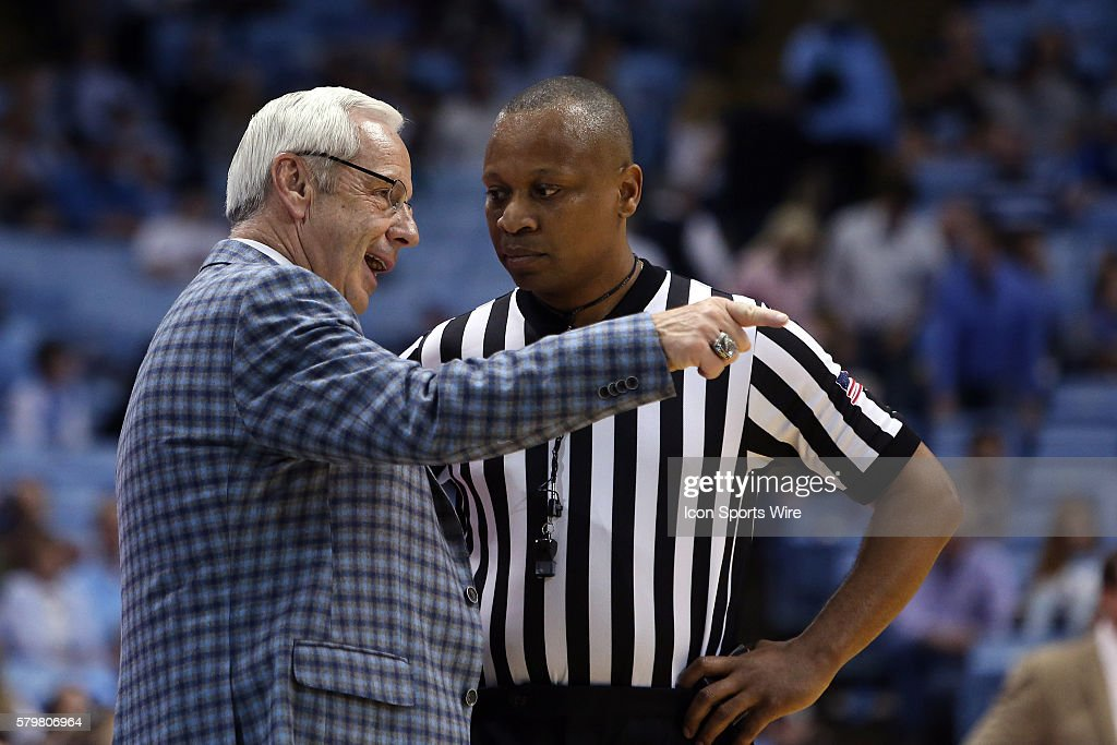 UNC head coach Roy Williams (left) talks with referee Michael Stephens (right). The University of North Carolina Tar Heels played the University of Alabama Birmingham Blazers in an NCAA Division I Men's basketball game at the Dean E. Smith Center in Chapel Hill, North Carolina. UNC won the game 89-58.