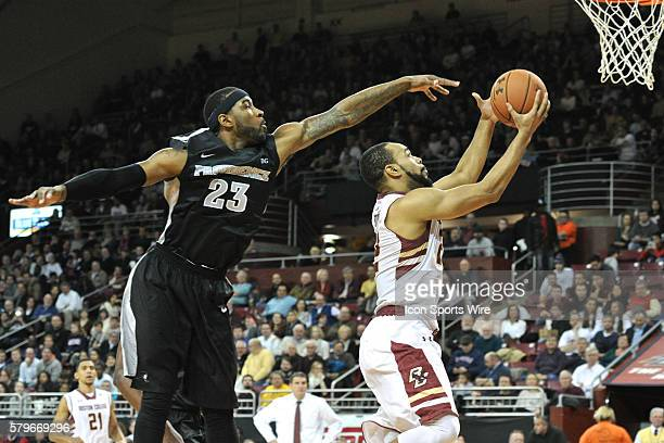 Boston College Eagles forward Aaron Brown beats Providence Friars forward LaDontae Henton to the basket during the Boston Eagles game against the...