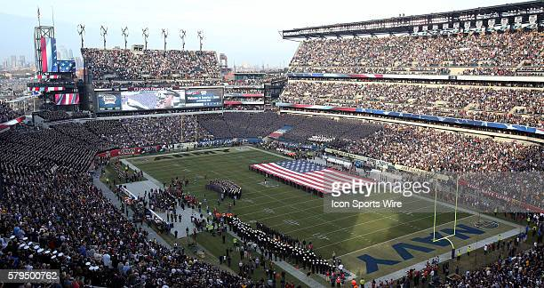 An American Flag is displayed on the field before a match between Army and Navy at Lincoln Financial Field in Philadelphia Pennsylvania