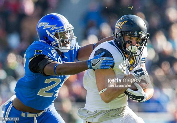 California Golden Bears tight end Raymond Hudson catches a pass for a first down as Air Force Falcons defensive back Tyler Weaver defends during the...