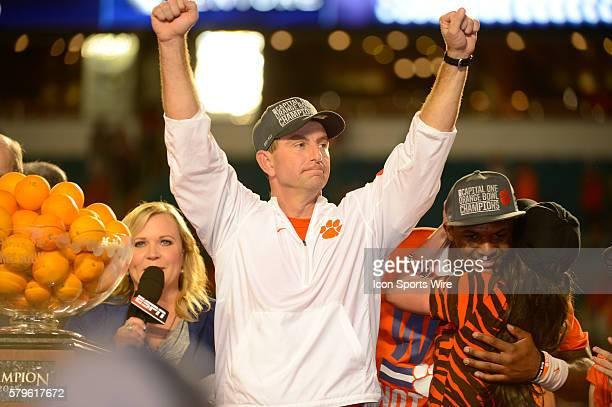 Clemson Tigers Head Coach Dabo Swinney raises his arms as his wife Kathleen Swinney hugs Clemson Tigers Quarterback Deshaun Watson as they celebrate...