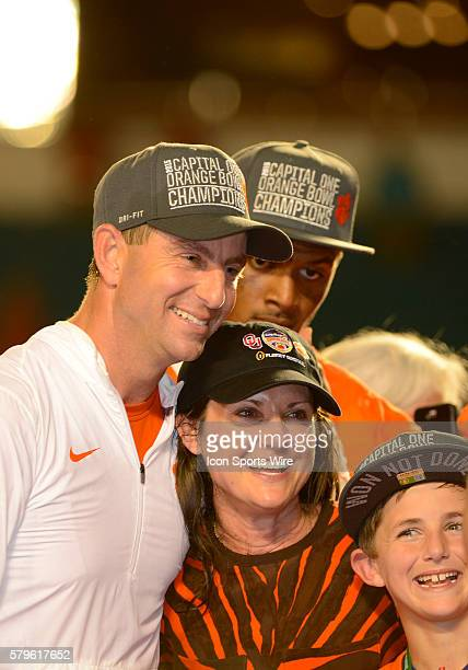 Clemson Tigers Head Coach Dabo Swinney smiles as he poses with his wife Kathleen Swinney and his son along with Clemson Tigers Quarterback Deshaun...