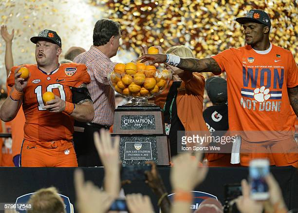 Clemson Tigers linebacker Ben Boulware and Clemson Tigers quarterback Deshaun Watson celebrates during the Trophy Presentation at the NCAA College...
