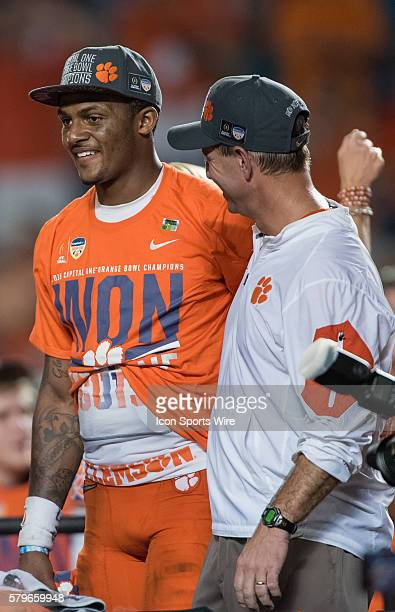 Clemson Tigers quarterback Deshaun Watson and Clemson Tigers head coach Dabo Swinney celebrate in action during the College Football Playoff...