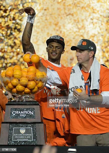 Clemson Tigers quarterback Deshaun Watson and Head Coach Dabo Swinney celebrates during the Trophy Presentation at the NCAA College Football Playoff...