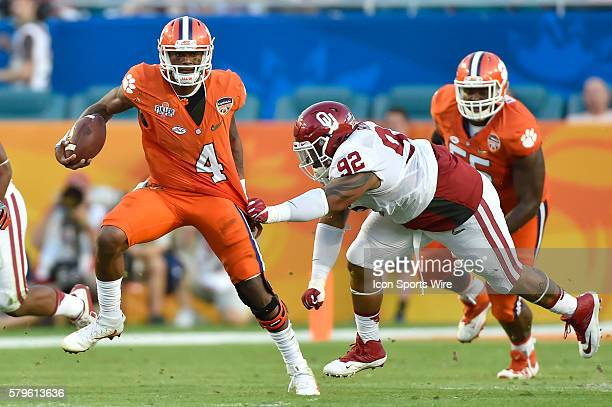 Clemson Tigers quarterback Deshaun Watson battles with Oklahoma Sooners defensive tackle Matthew Romar in action during the College Football Playoff...