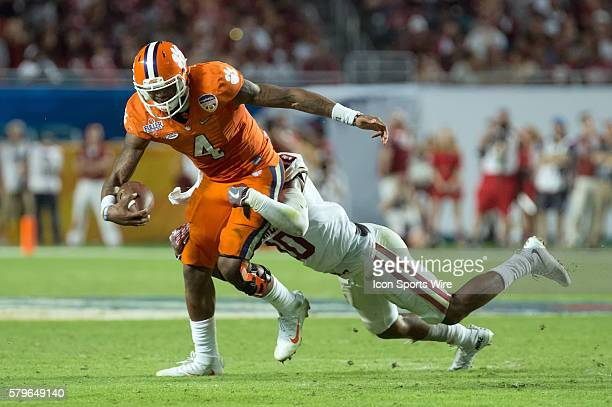 Clemson Tigers quarterback Deshaun Watson battles with Oklahoma Sooners safety Steven Parker in action during the College Football Playoff Semifinal...