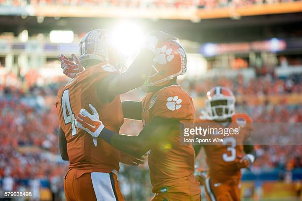 Clemson Tigers quarterback Deshaun Watson celebrates with teammates after scoring a touchdown in action during the College Football Playoff Semifinal...