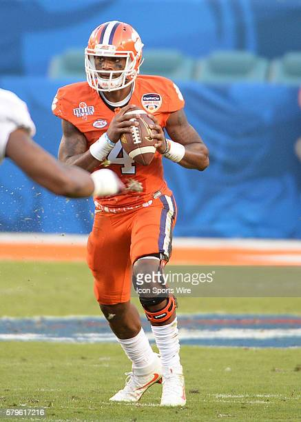 Clemson Tigers quarterback Deshaun Watson looks down field during the first half at the NCAA College Football Playoff Semifinal at the Capital One...
