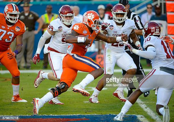 Clemson Tigers Quarterback Deshaun Watson runs with the ball during the NCAA College Football Playoff Semifinal at the Capital One Orange Bowl game...