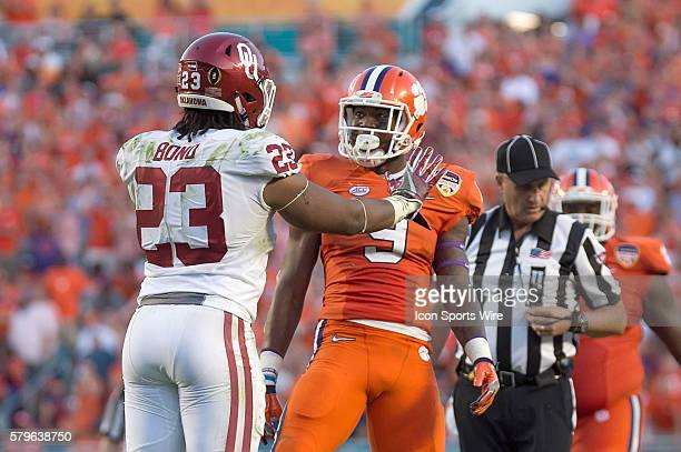 Clemson Tigers running back Wayne Gallman taunts Oklahoma Sooners linebacker Devante Bond after a play in action during the College Football Playoff...