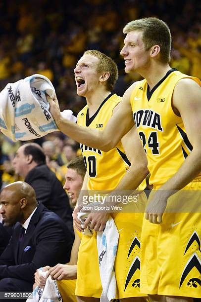 Iowa Hawkeyes guard Mike Gesell and Iowa Hawkeyes guard Brady Ellingson celebrate from the bench during a Big Ten Conference basketball game between...