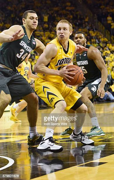 Iowa Hawkeyes guard Mike Gesell gets ready to shoot during a Big Ten Conference basketball game between the Michigan State Spartans and the Iowa...