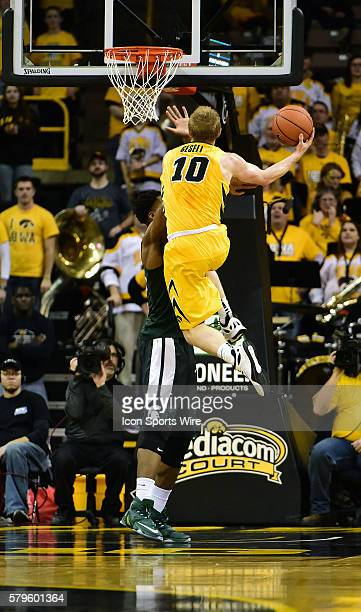 Iowa Hawkeyes guard Mike Gesell goes up for a shot during a Big Ten Conference basketball game between the Michigan State Spartans and the Iowa...