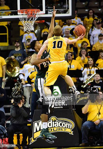 Iowa Hawkeyes guard Mike Gesell tries to put in a one-handed dunk during a Big Ten Conference basketball game between the Michigan State Spartans and...