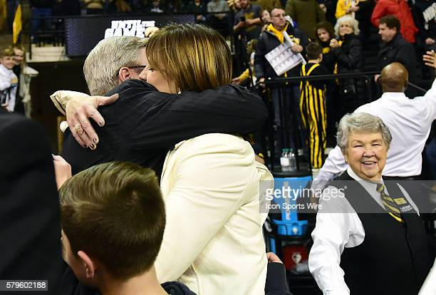 Iowa Hawkeyes head basketball coach Fran McCaffery gets a hug from his wife, Margaret, after a Big Ten Conference basketball game between the...
