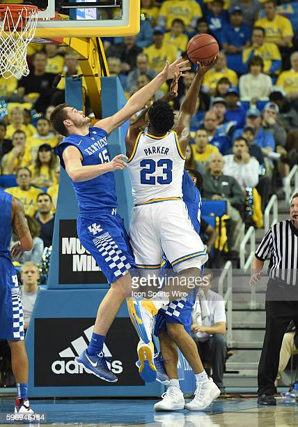 Kentucky Isaac Humphries attempts to block a shot by UCLA Tony Parker during an NCAA basketball game between the Kentucky Wildcats and the UCLA...