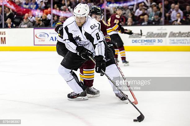 Lake Erie Monsters D Jan Hejda controls the puck against Chicago Wolves RW Ty Rattie during the first period of the AHL hockey game between the...