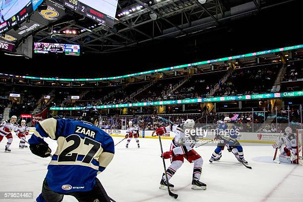 Lake Erie Monsters RW Daniel Zaar is defended by Grand Rapids Griffins D Xavier Ouellet during the second period of the AHL hockey game between the...