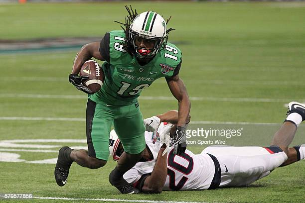 Marshall Thundering Herd wide receiver Deandre Reaves breaks tackle from Connecticut Huskies safety Obi Melifonwu after catching a pass in the 2nd...