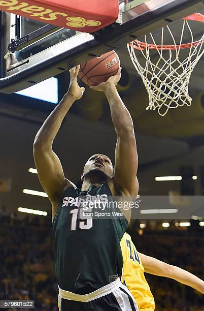 Michigan State Spartans forward Marvin Clark puts up a shot in the first half over Iowa Hawkeyes guard Brady Ellingson during a Big Ten Conference...