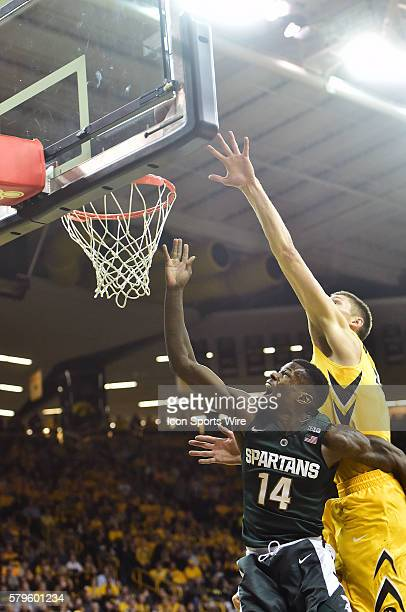 Michigan State Spartans guard Eron Harris and Iowa Hawkeyes forward Jarrod Uthoff battle for a rebound during a Big Ten Conference basketball game...