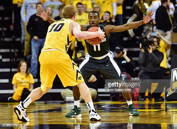Michigan State Spartans guard Lourawls Nairn Jr. Guards Iowa Hawkeyes guard Mike Gesell during a Big Ten Conference basketball game between the...