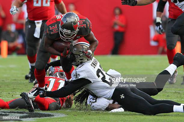 New Orleans Saints cornerback Damian Swann is injured as he makes a tackle on Tampa Bay Buccaneers running back Charles Sims in the 4th quarter of...