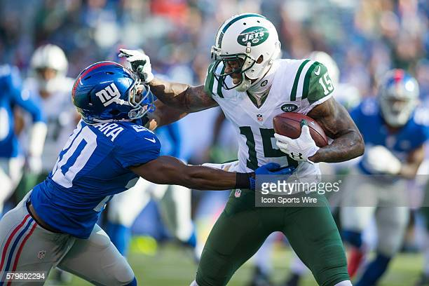 New York Jets wide receiver Brandon Marshall stiff arms New York Giants cornerback Prince Amukamara during a week 13 NFL matchup between the New York...
